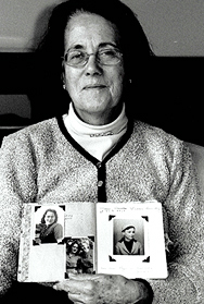 Ms. Pawel holding photos of family