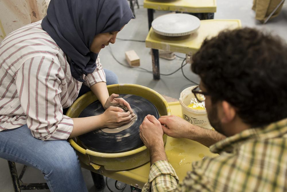 moore college student on pottery wheel