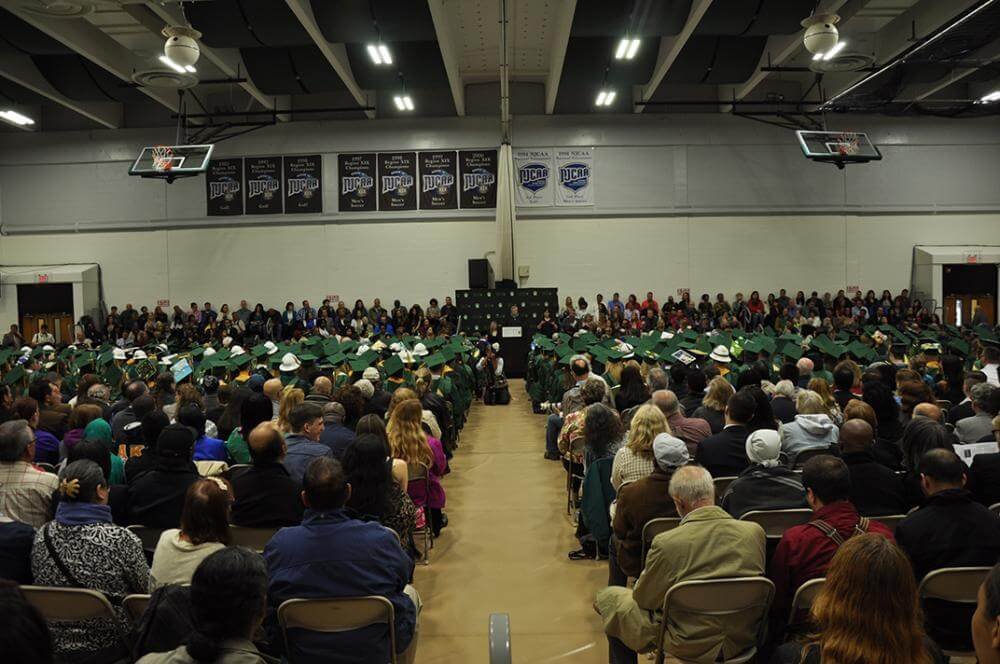 grads and audience in gym