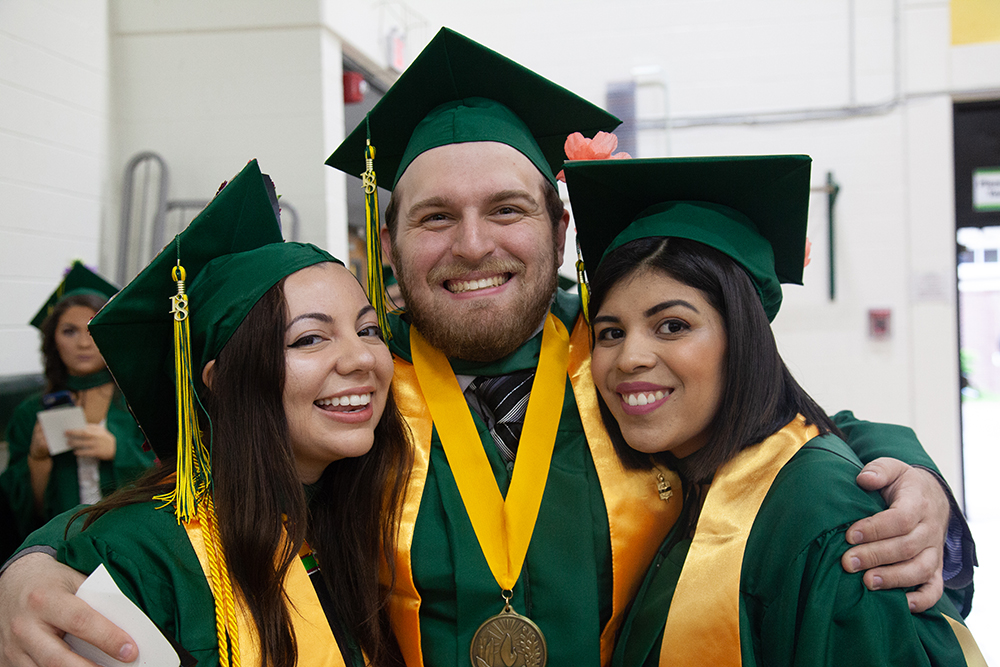 two female and one male grad
