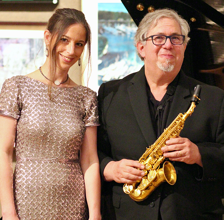 cropped photo of anna keiserman and paul cohen sax player