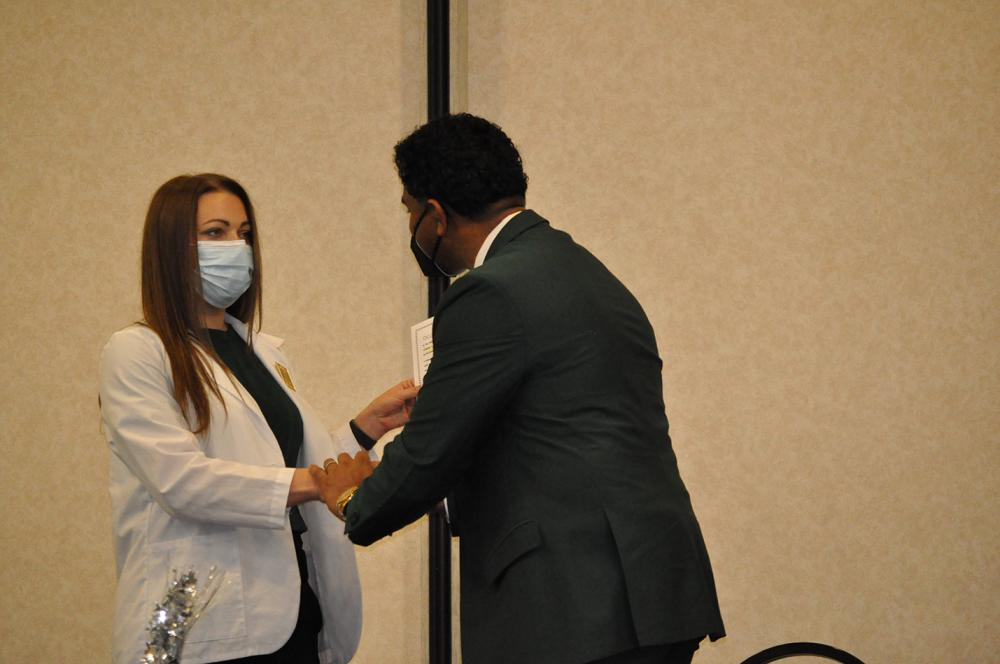 beau younker with female ota student at pinning ceremony