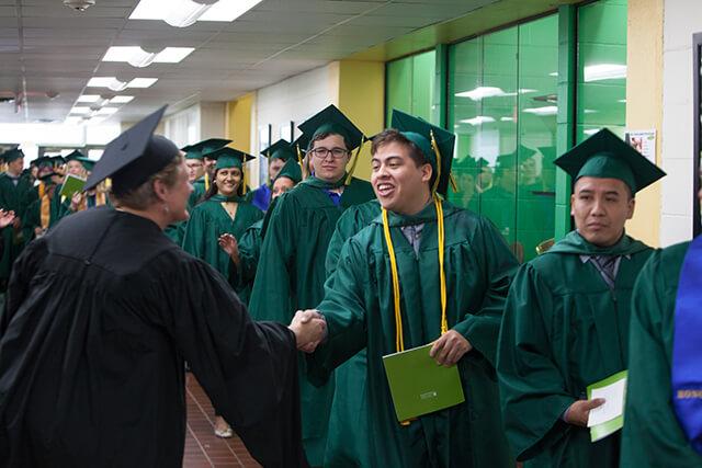 line of grades with handshake