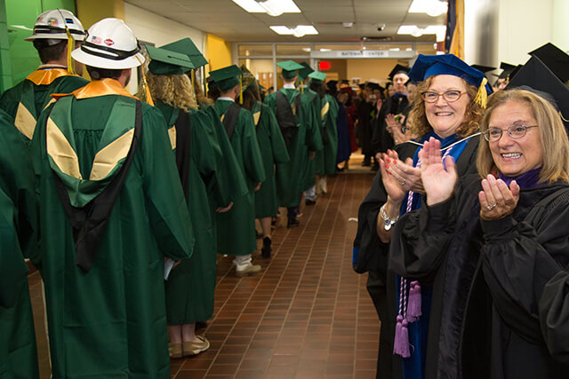 faculty clapping grads