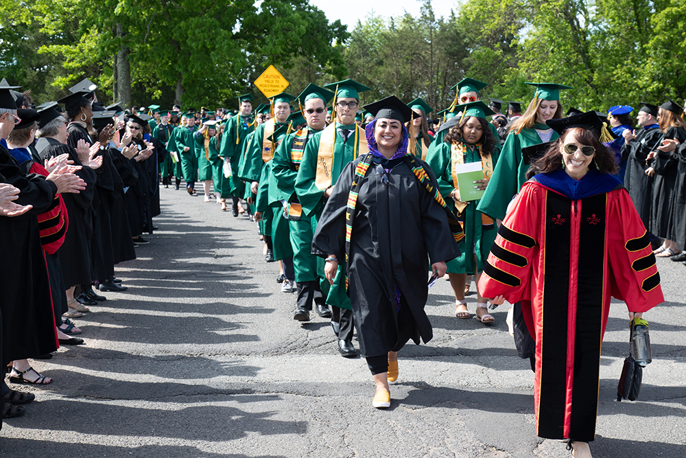 commencement marching grads and applauding faculty