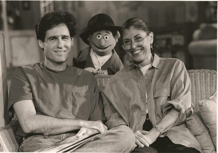 black and white image of author, puppet and another person