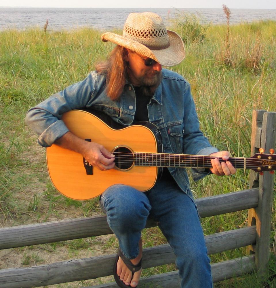 Mike Aiken with guitar