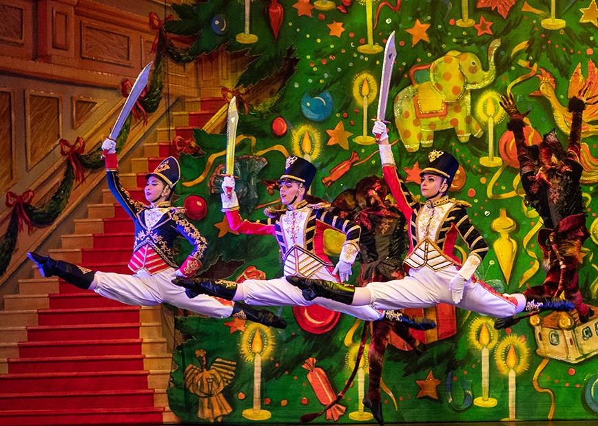 3 nutcracker dancers leaping in air