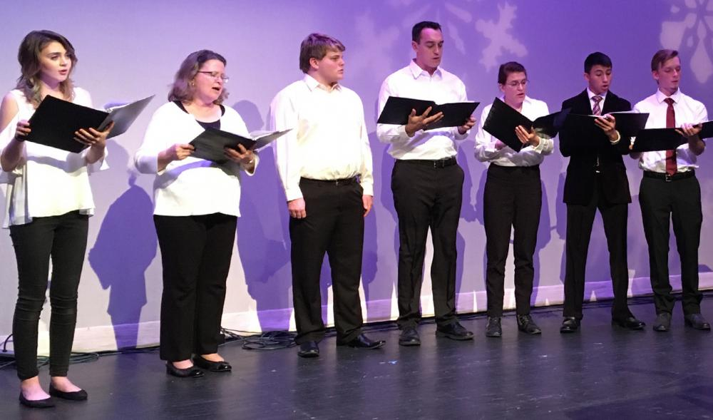 line of singers with purple background