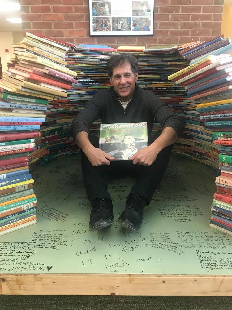author with stacks of books
