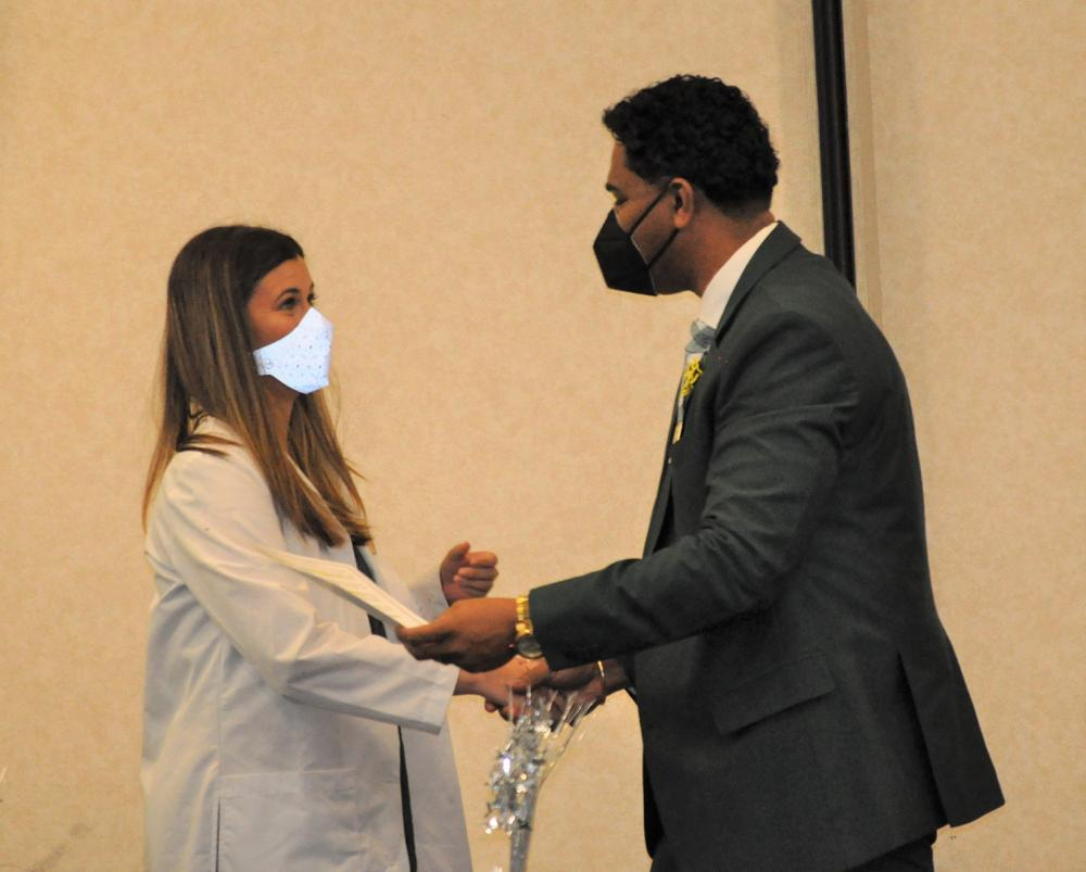 ota female student and beau younker at pinning ceremony