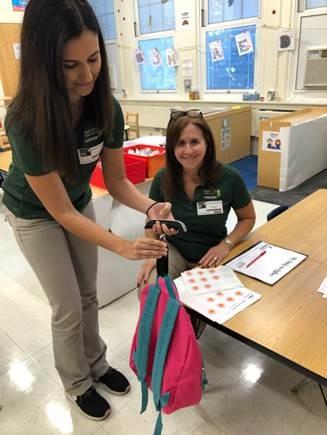 2 ota students measuring bag