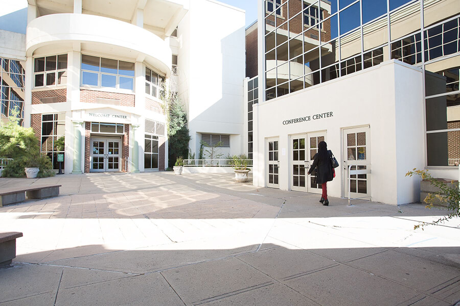 front entrance with person walking