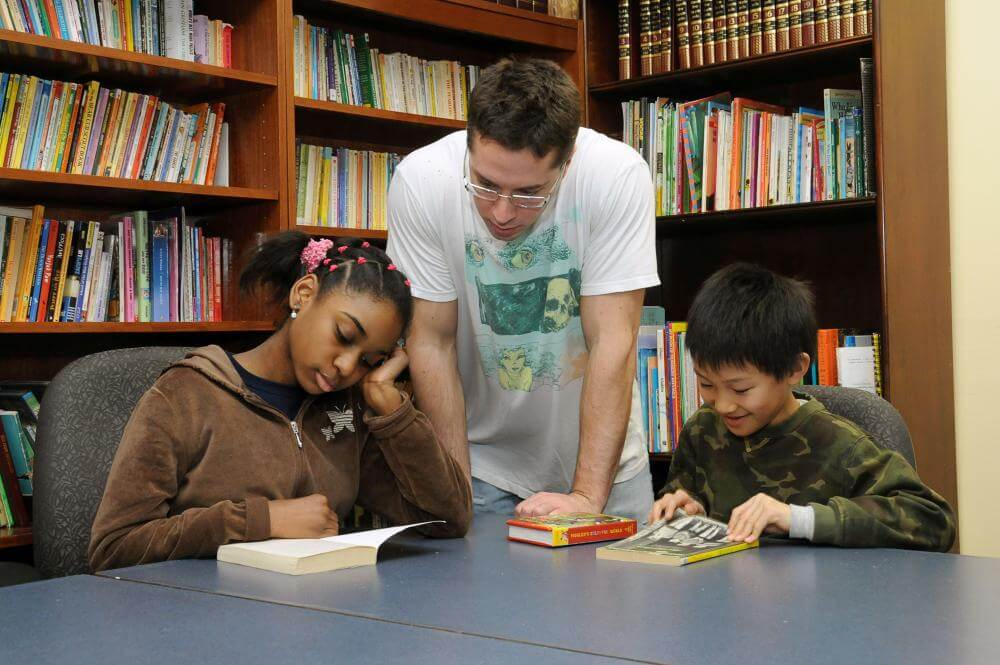 service learning student and kids