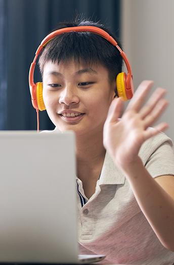teen boy waving