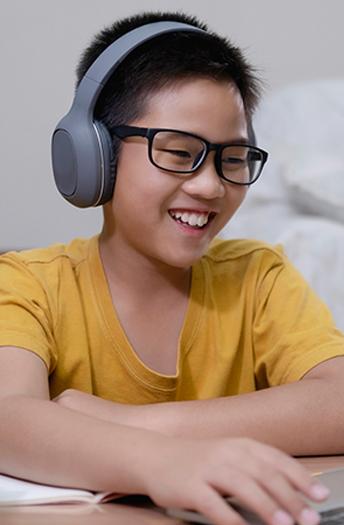boy having fun on computer