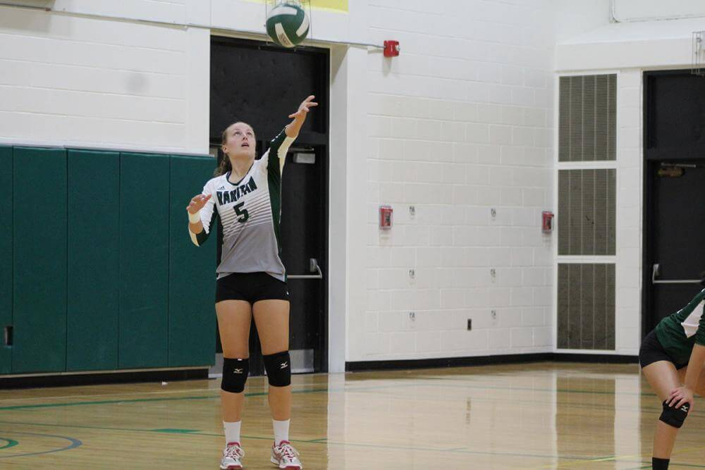 ball above volleyball player's head