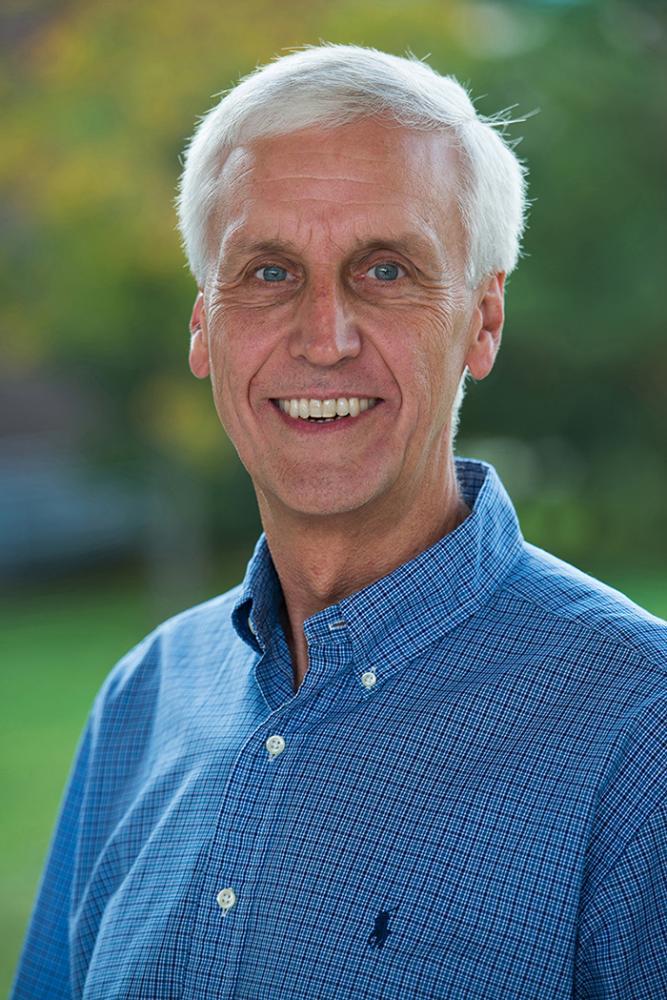 bill klinger in blue shirt
