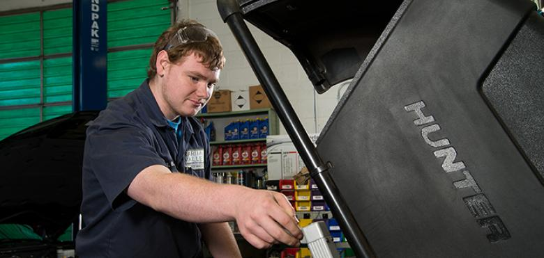 young man working on car
