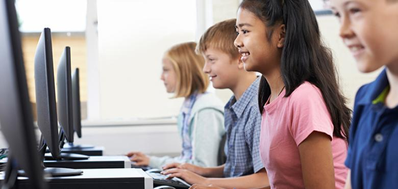 elementary students in computer lab
