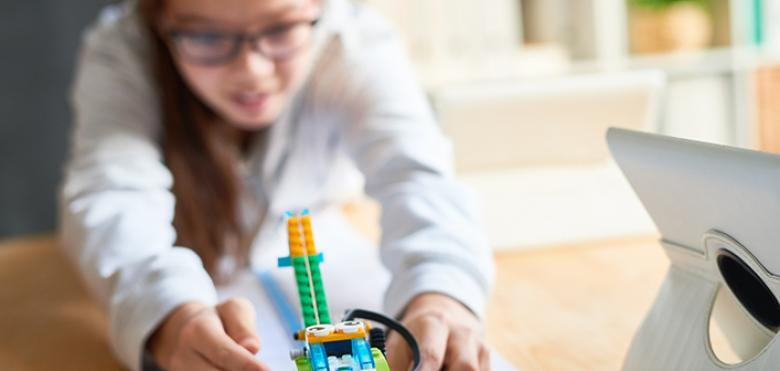 girl with lego style robot