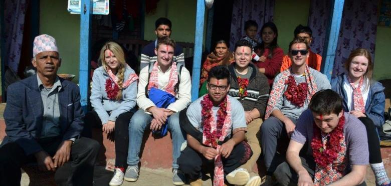 RVCC students with Nepalese family
