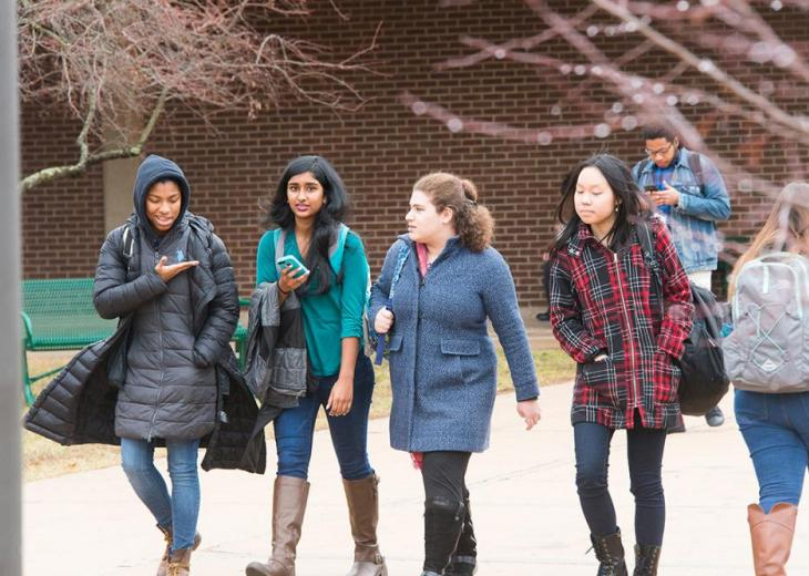 row of female students walking outside