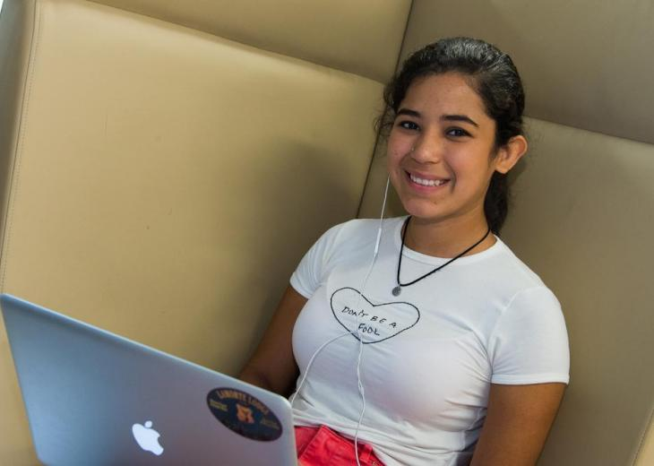 girl in white t shirt and laptop