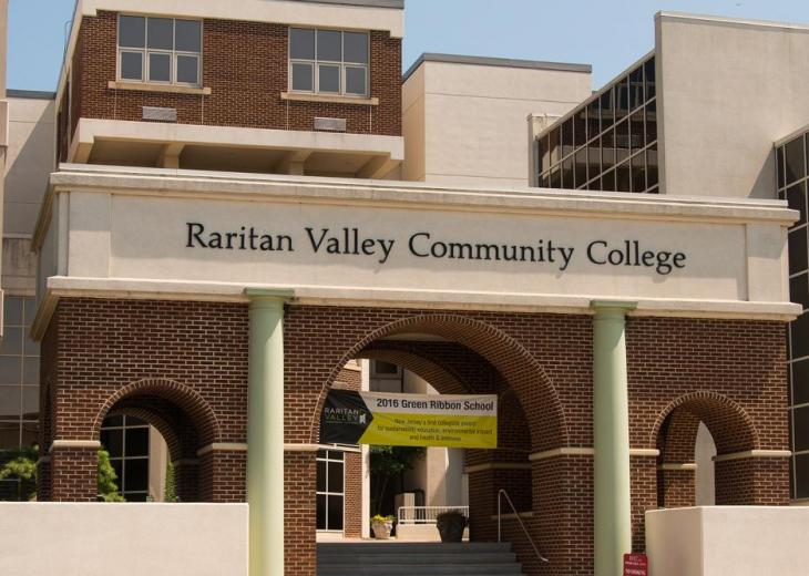 detail of RVCC sign and arches at front of college
