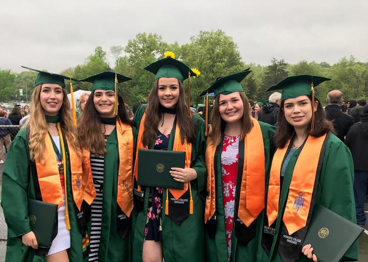 row of female honors college grads