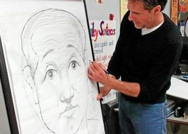 author catalanotto drawing on easel