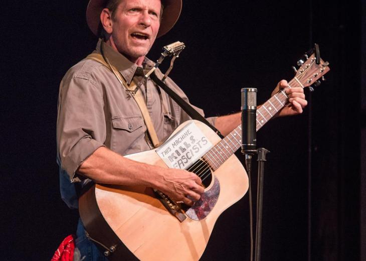 Randy Noojin as Woody Guthrie