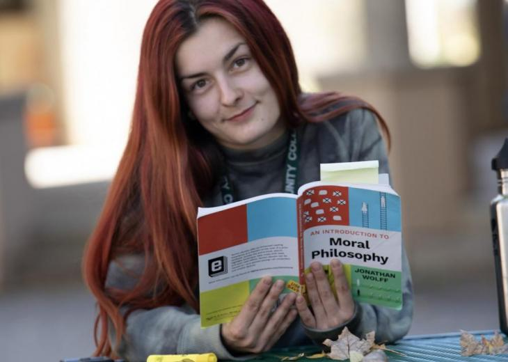 red-haired girl with moral philsophy book