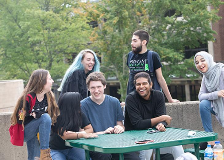 group of students around table outside