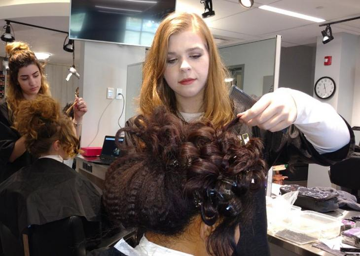 2 students styling period hair