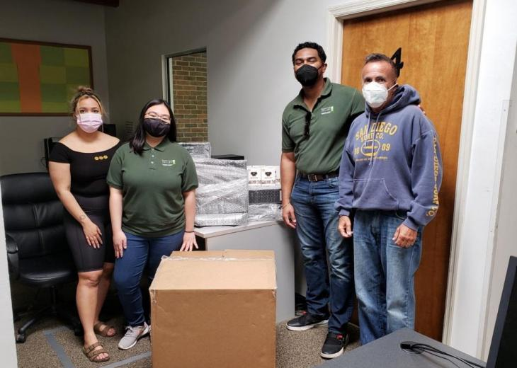 rvcc ota students with collected boxes of technology