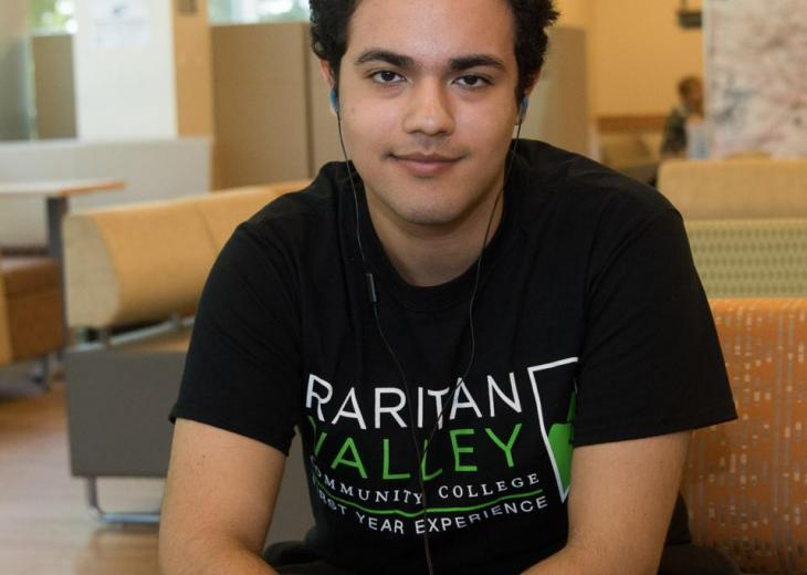 student at laptop cropped at bottom
