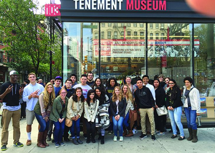 honors college students at tenement museum