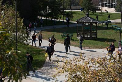 several students walking outside on campus
