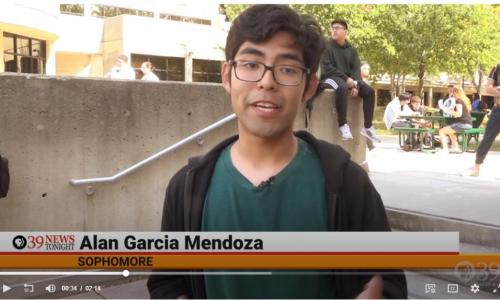 Alan Mendoza being interviewed in courtyard