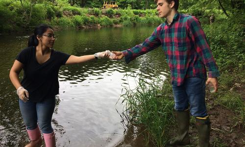 2 students doing stream sampling