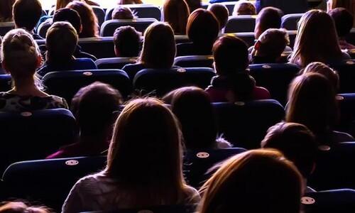 backs of audience members
