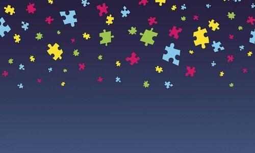 floating autism puzzle pieces