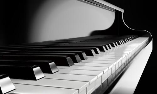 black keys on black piano