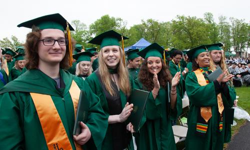 commencement group with honors student