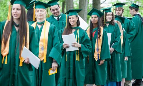 lines of graduates walking