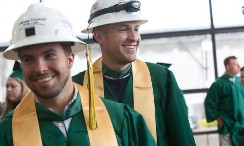 2 male grads wearing hard hats