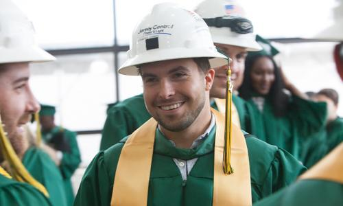 graduates in hard hats