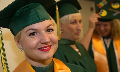 older female grad facing camera