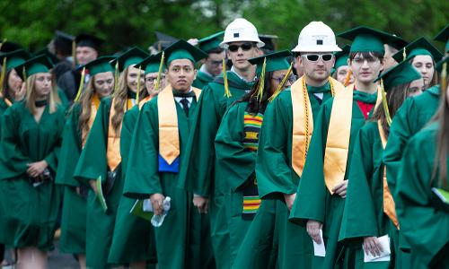 group of grads with 2 wearing sunglasses and hard hats